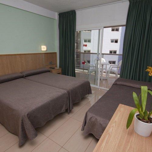 Chambre triple Hôtel Perla